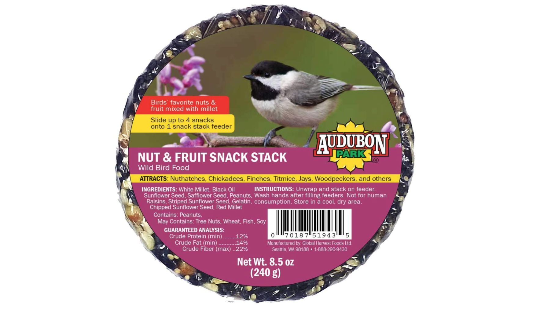 a round cake of various nuts and seeds and fruits, wrapped in plastic wrap with a picture of a chickadee on the front