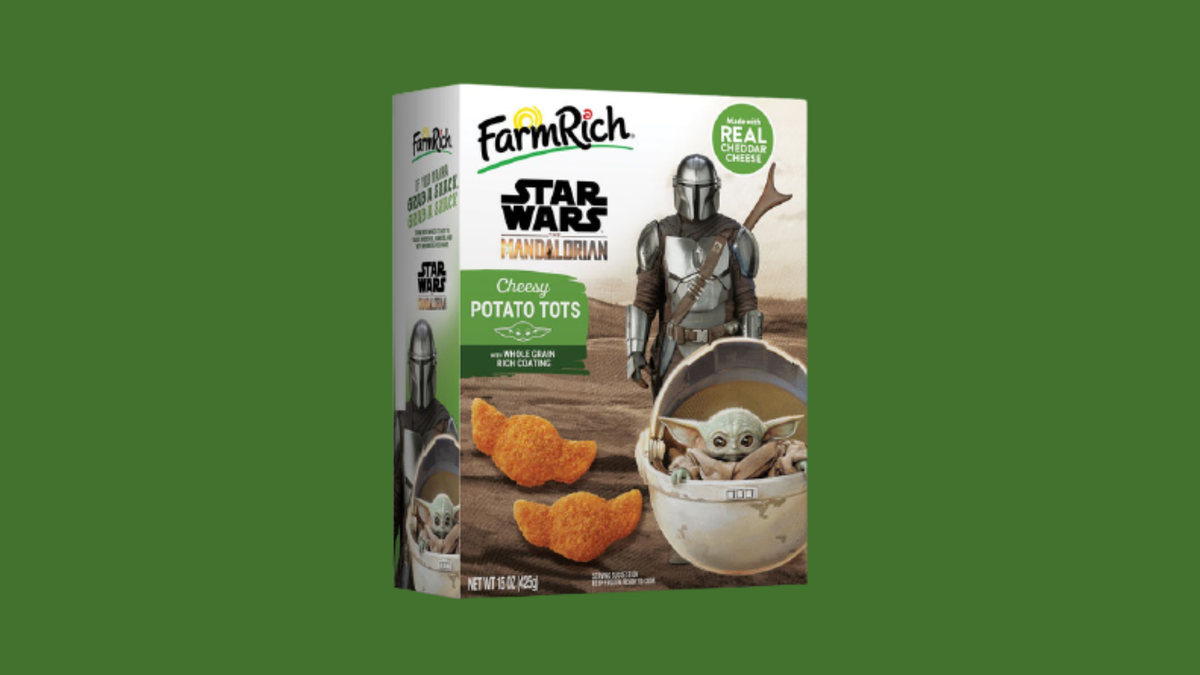 A package of Farm Rich cheesy tots shaped like Baby Yoda sits against a green backdrop.