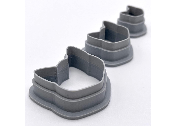 Three cat head shaped cutters in different sizes.