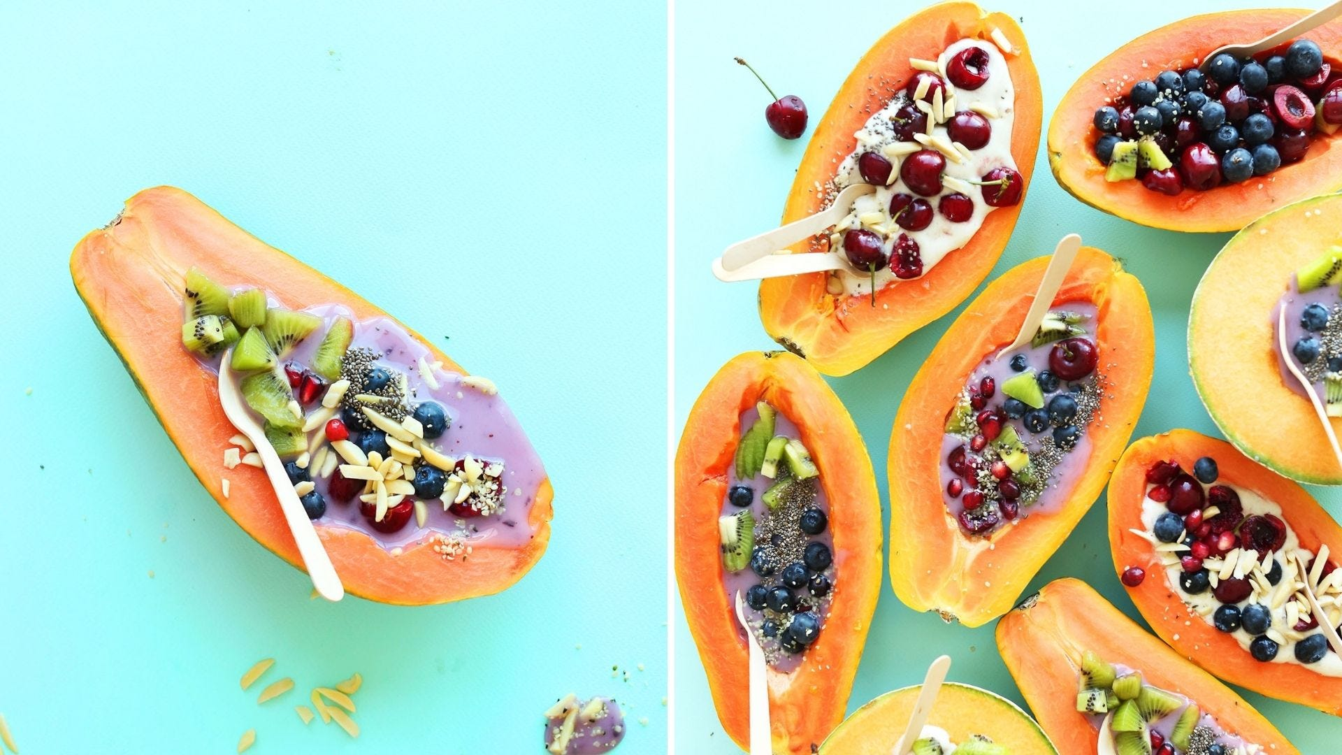Papayas filled with yogurt, fruit, and toppings.