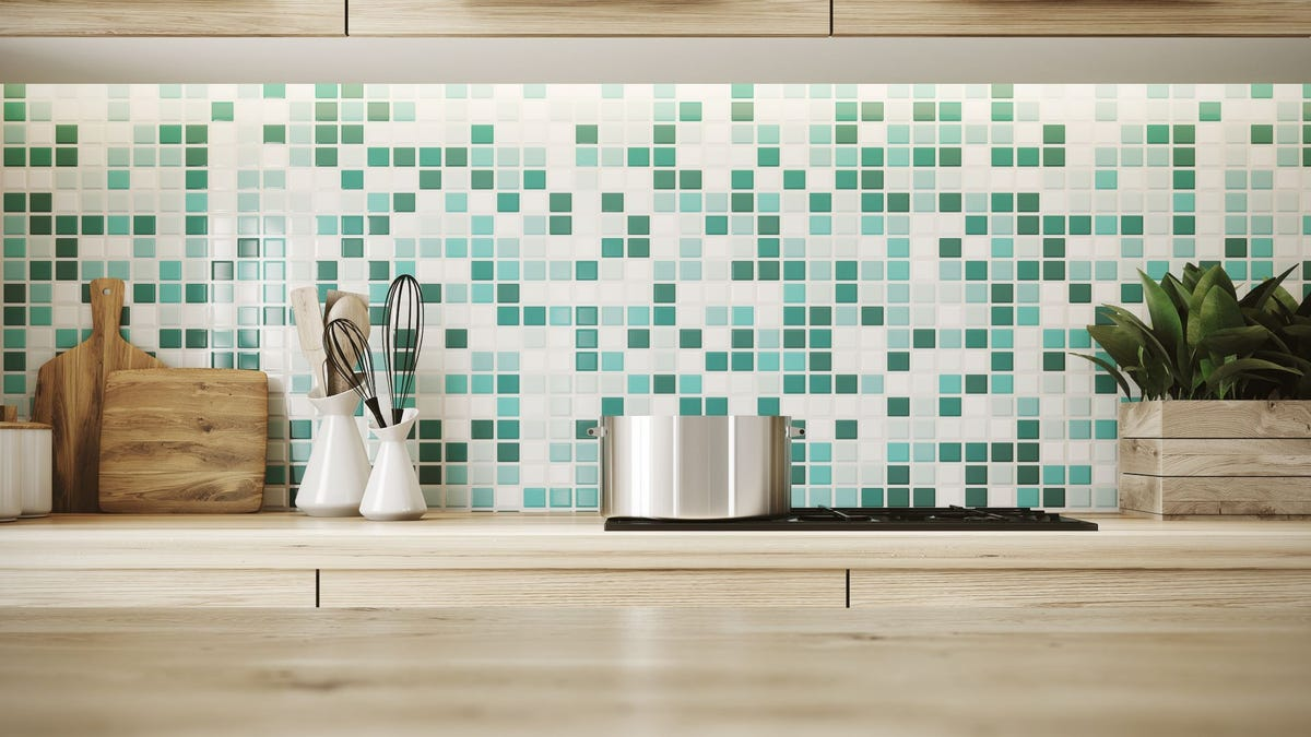 A green-and-white checkered backsplash behind a kitchen counter.