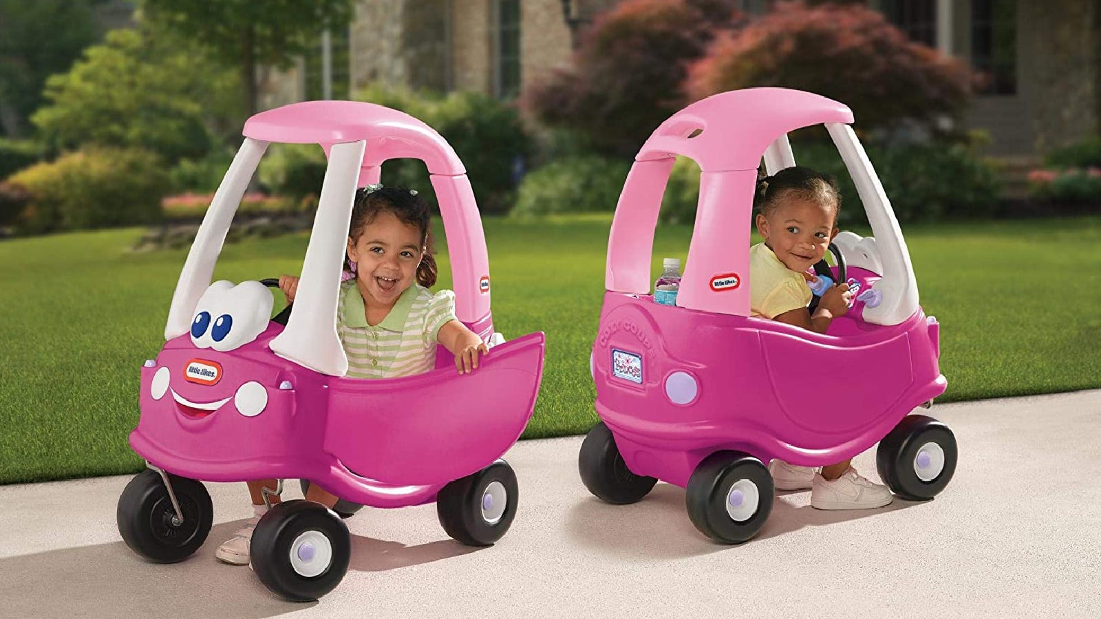 Two young girls playing with their Little Tikes Princess Buggies.