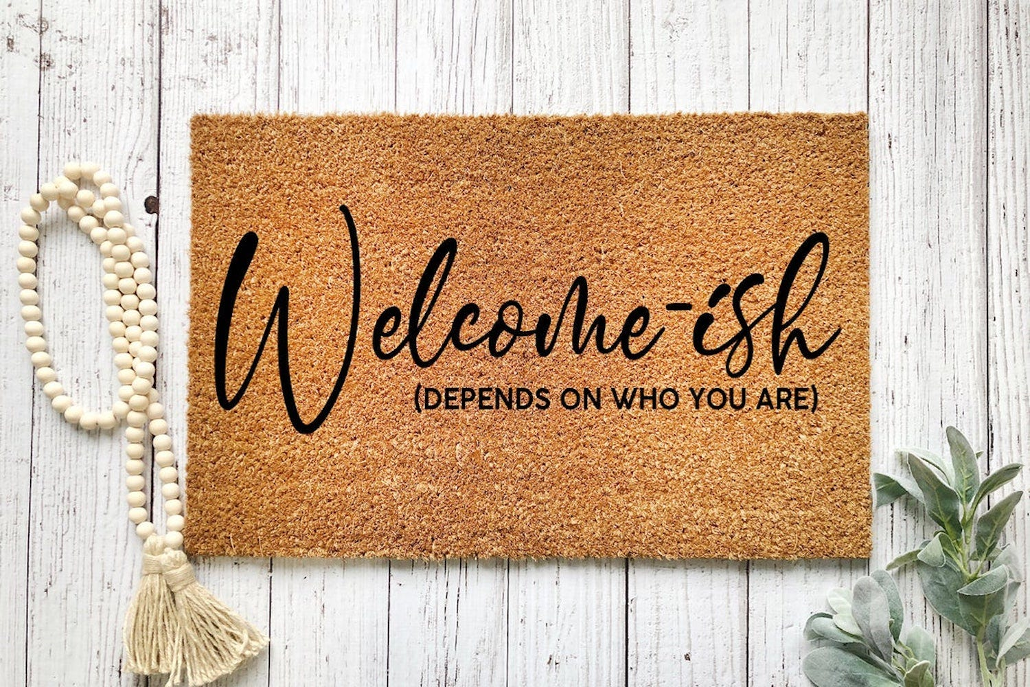 """A doormat reading """"Welcome-ish (Depends on Who You Are)"""""""