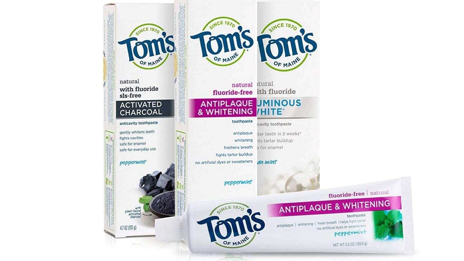 Three boxes of Tom's of Maine toothpaste.