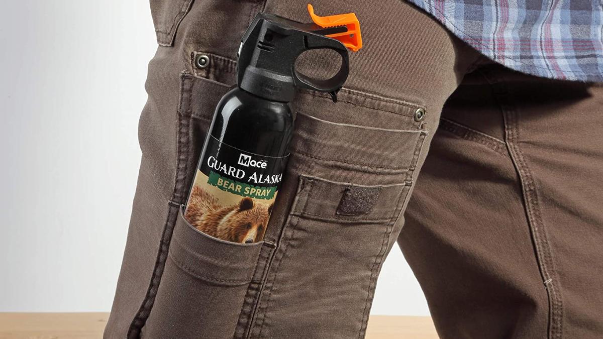 can of bear spray in a pants leg pocket