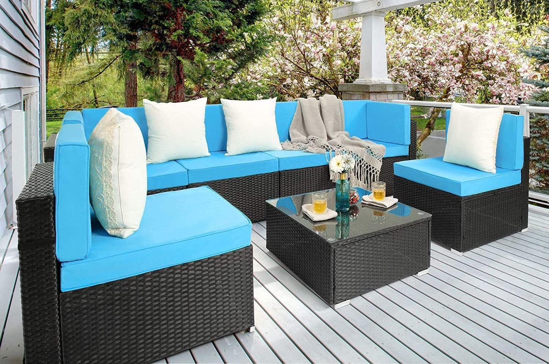 A blue-cushioned patio furniture set
