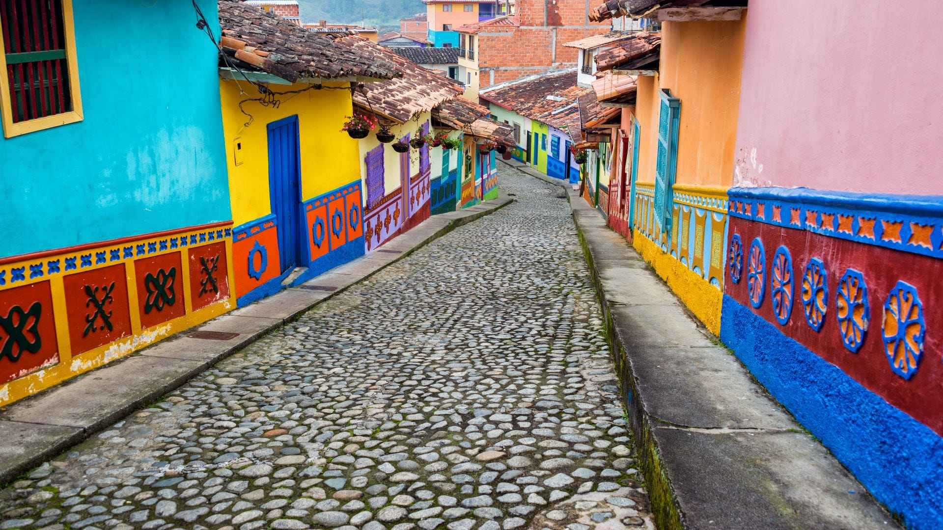 Colorful houses along a cobblestone street in Columbia.