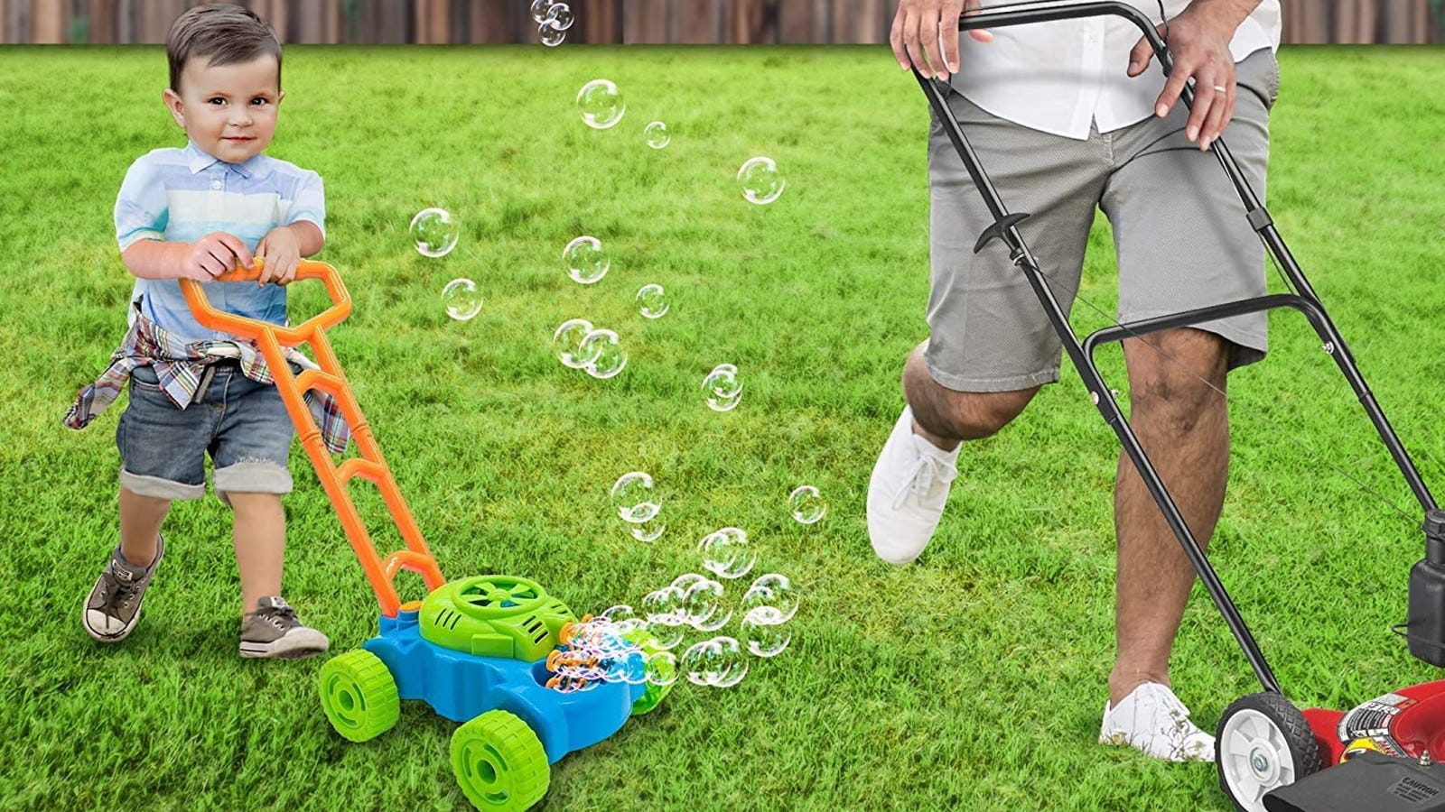 little boy pushing a lawnmower that is also a bubble machine