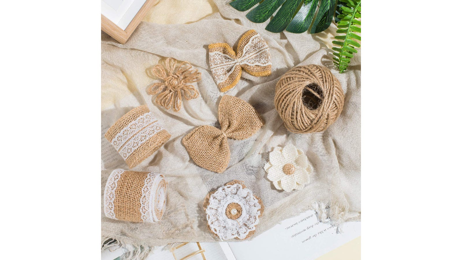 burlap and lace ribbons, flowers, and bows on a burlap sack background