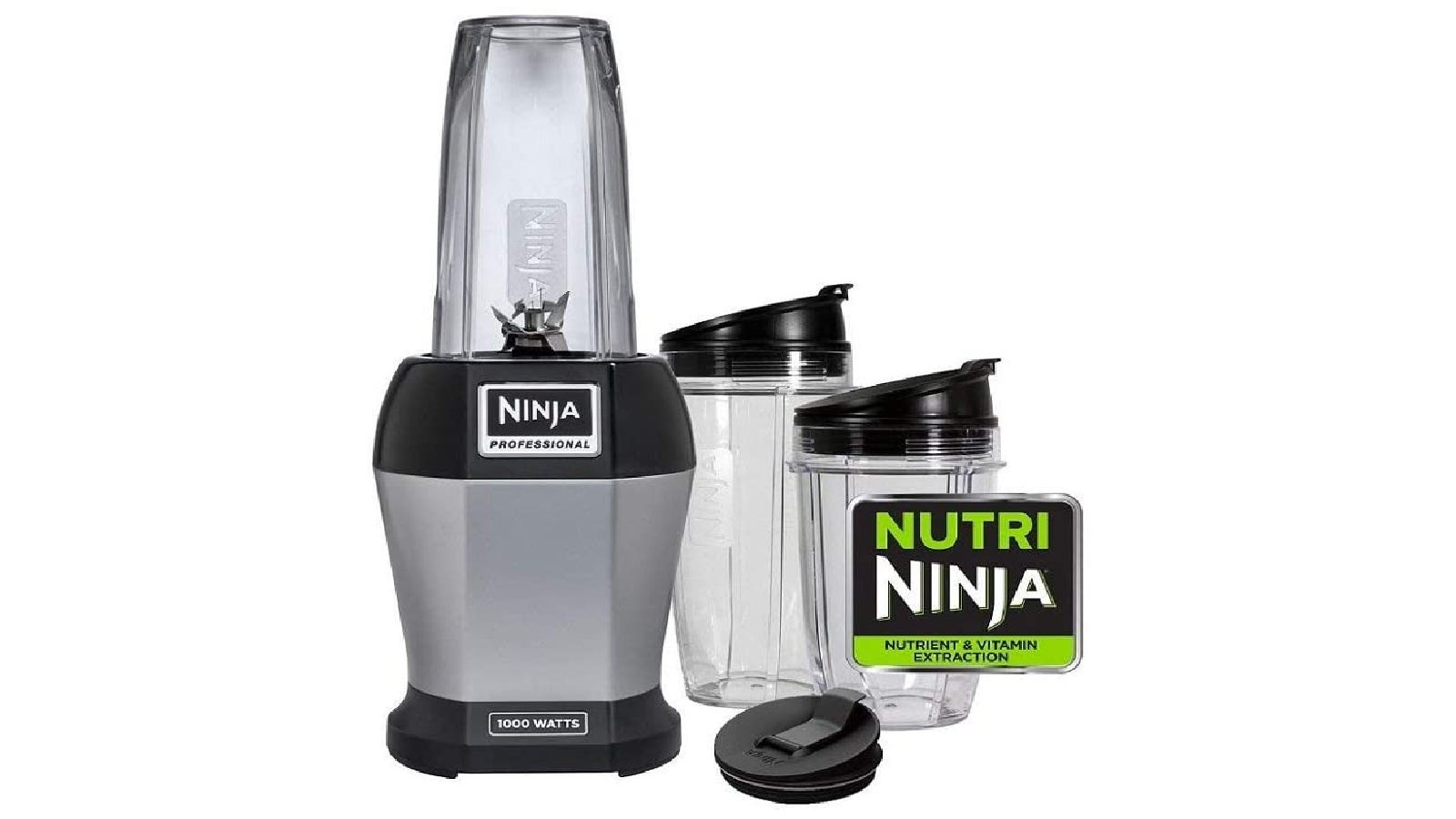 """a personal blender with a gray base and a clear blender cup; to the right is another two blender cups and a label with the text """"Nutri Ninja"""""""