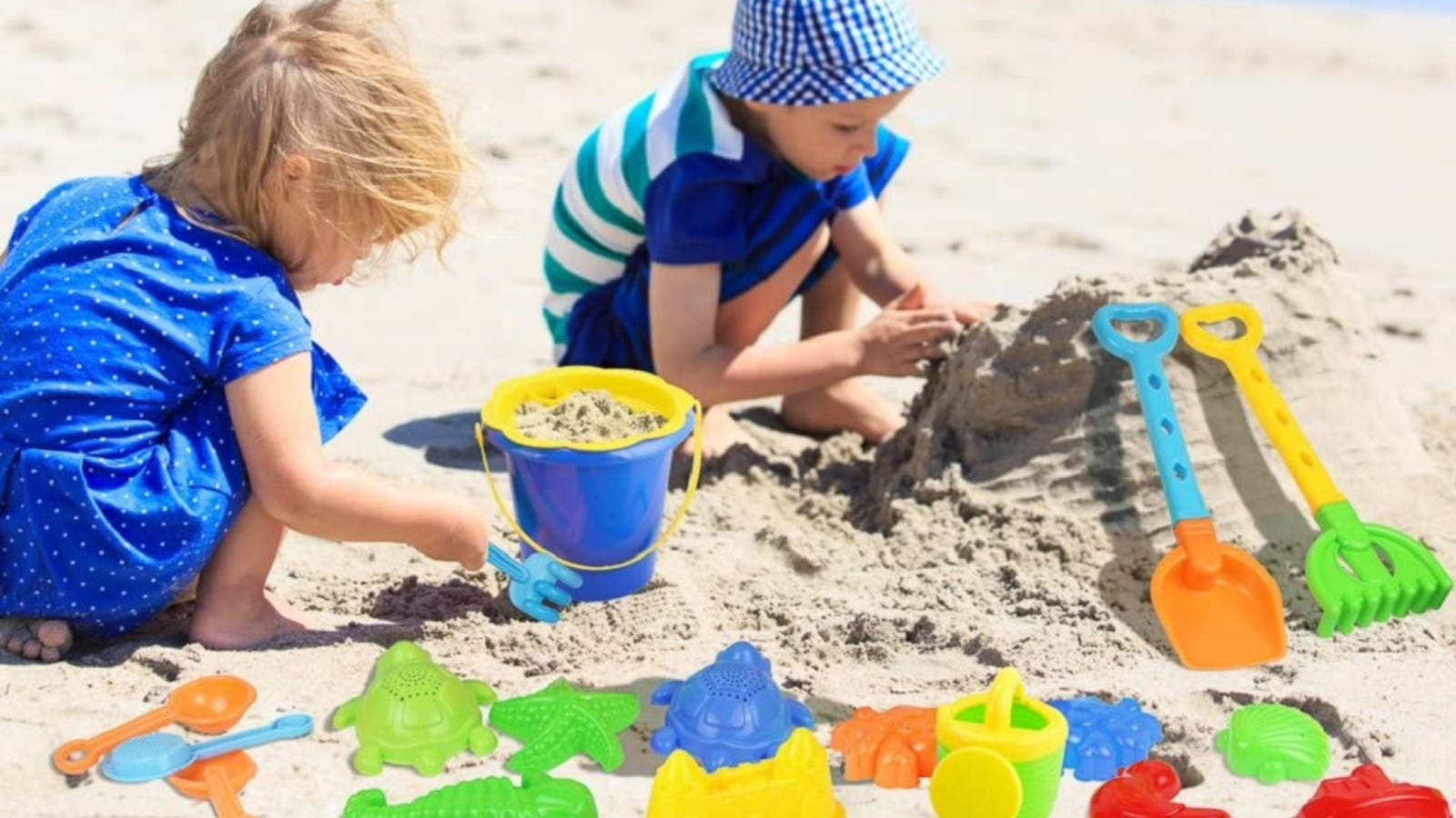Two young children playing with Click N Play sand toys.