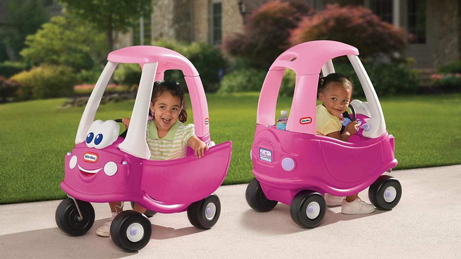 Two different pink Little Tikes coupe cars with two little girls riding in them
