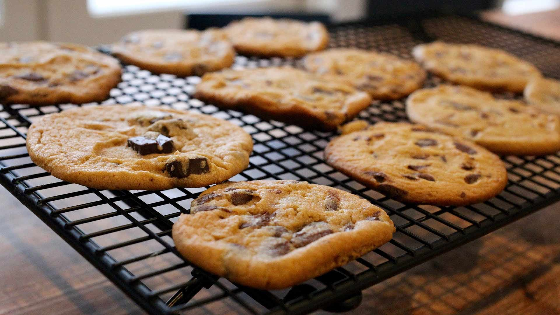 Thin and crispy chocolate chip cookies, cooling on a wire rack.