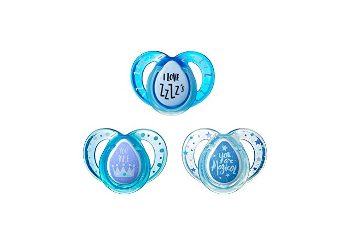 Three blue pacifiers with printed designs.