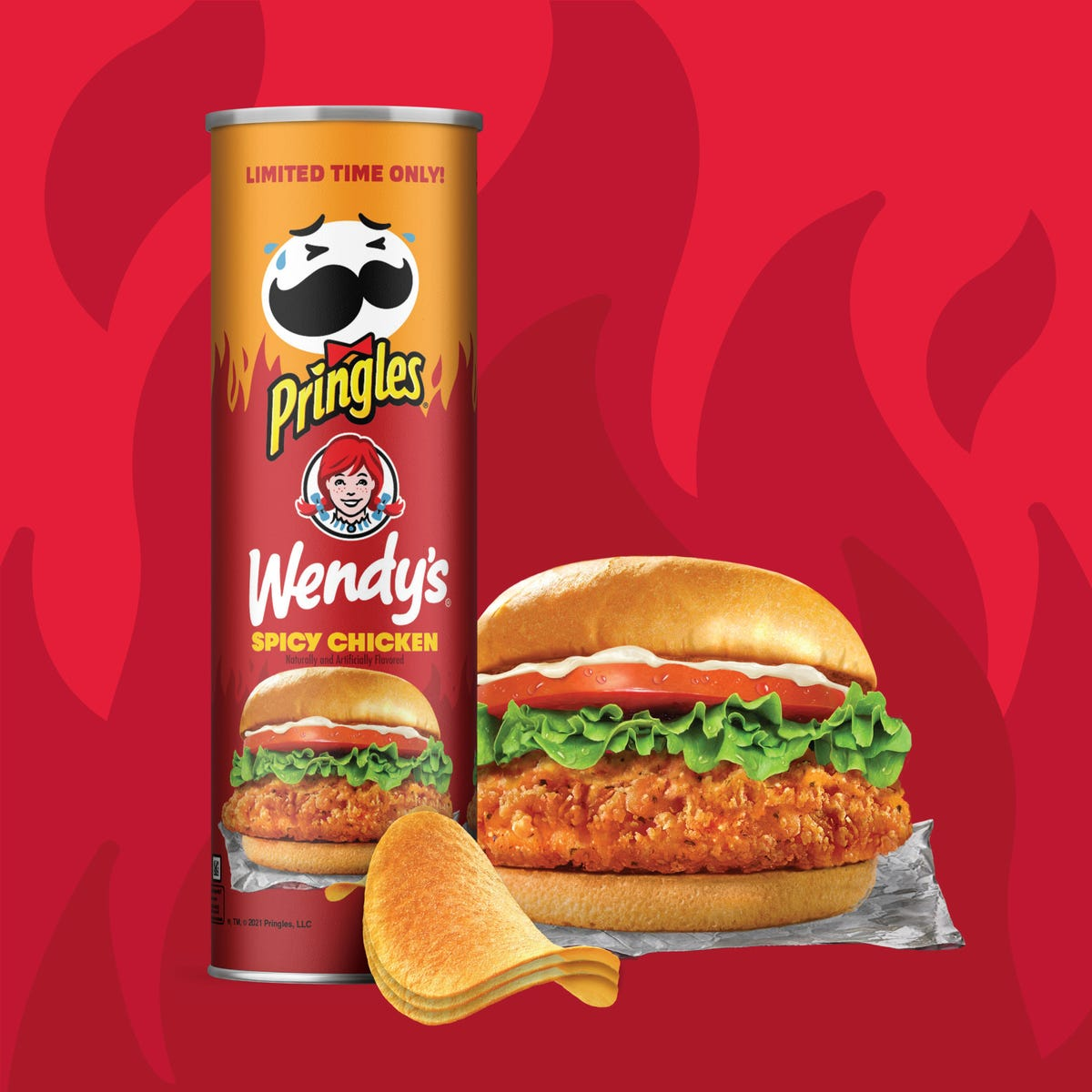 A can of Pringles sits next to a spicy chicken sandwich from Wendy's