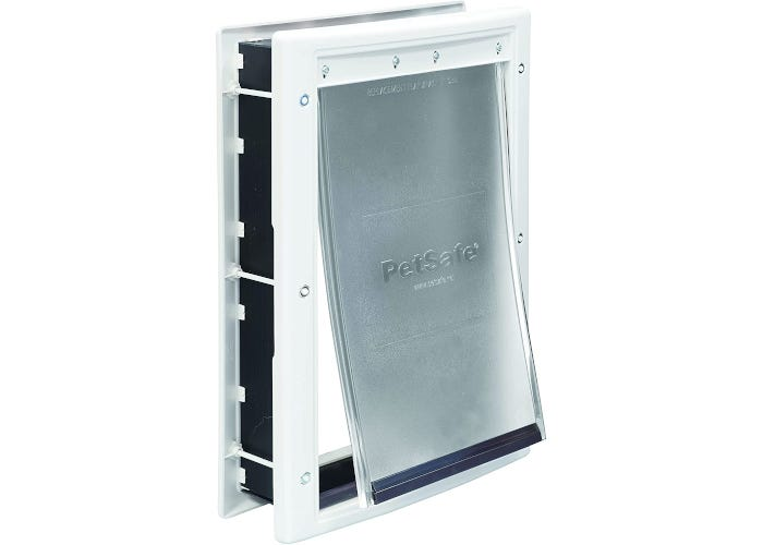 Plastic pet door for dogs and cats with snap on closing panel and paintable plastic frame