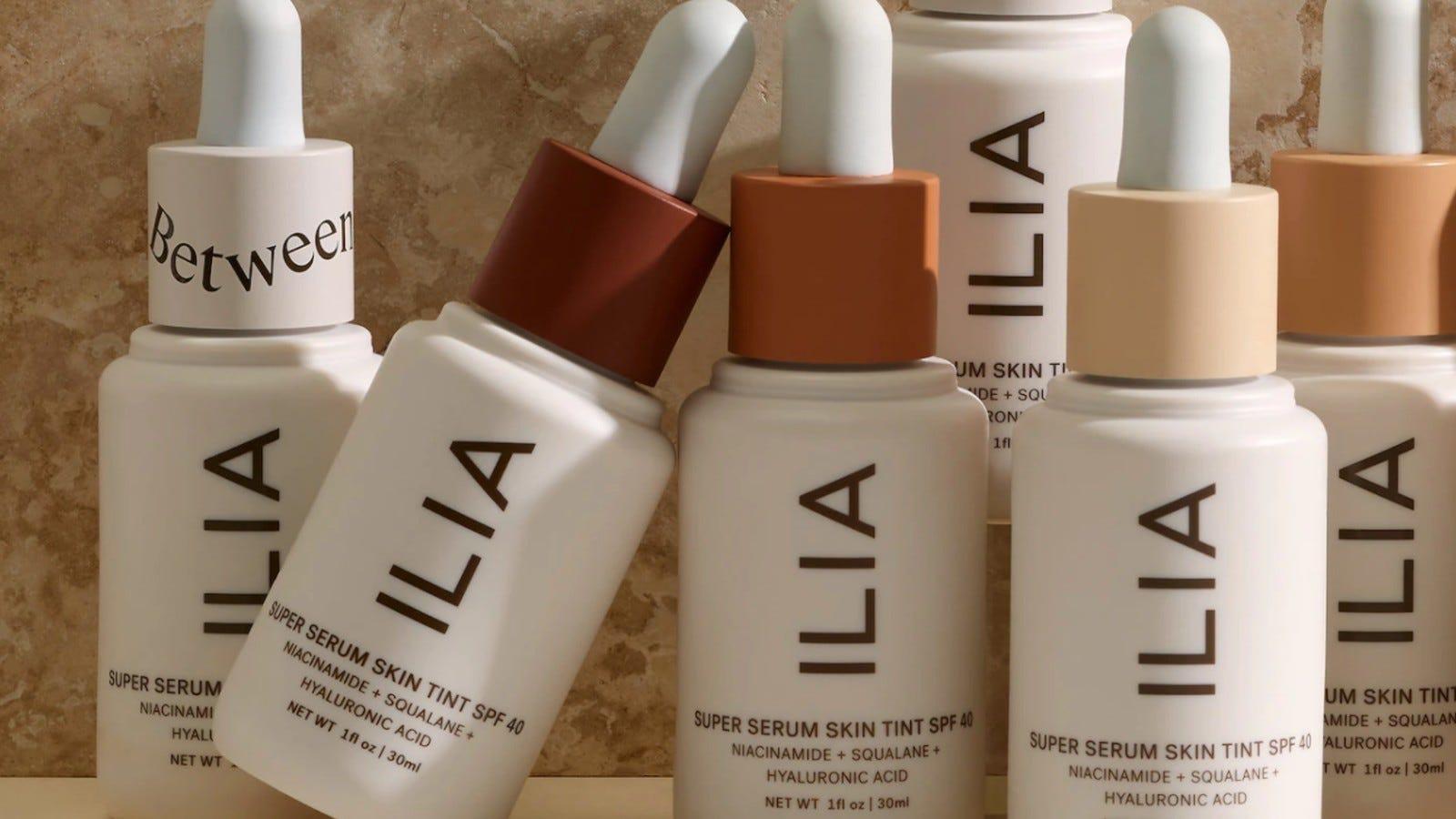 white bottles of Ilia Skin Serum in various shades
