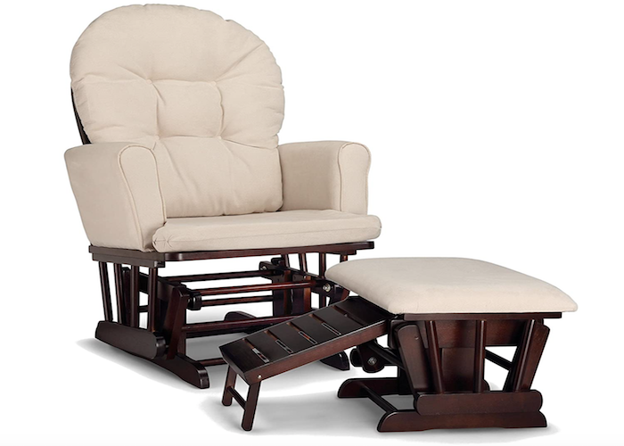 wooden framed nursing chair with cream-colored upholstery and a matching fold-up ottoman