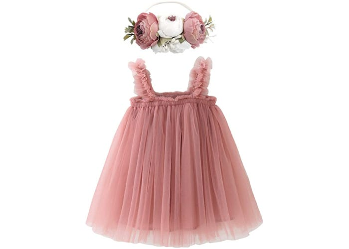 a small dusty pink tulle dress with matching flower headband