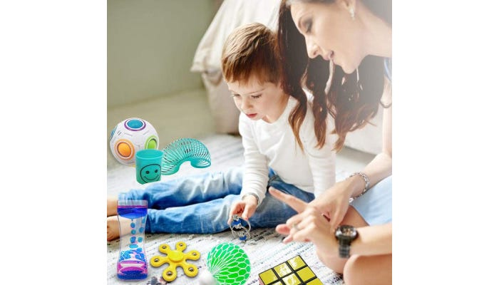 Woman and young boy playing with sensory toys.