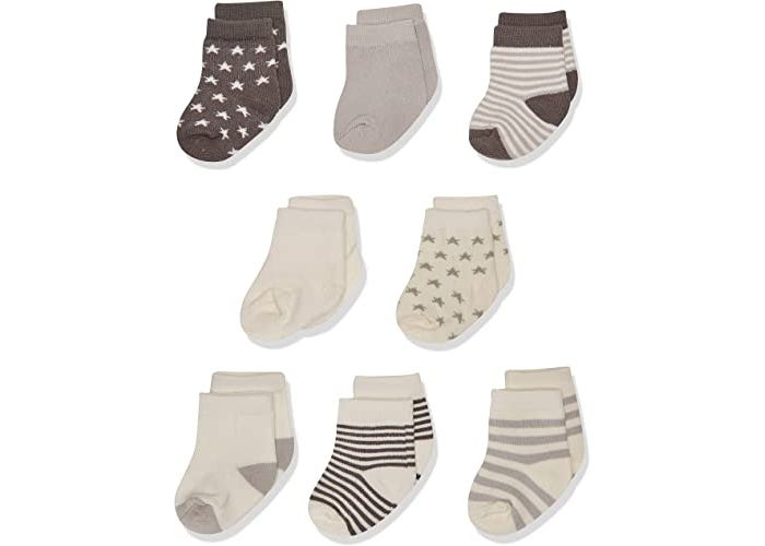 multiple neutral color baby socks displayed on white background