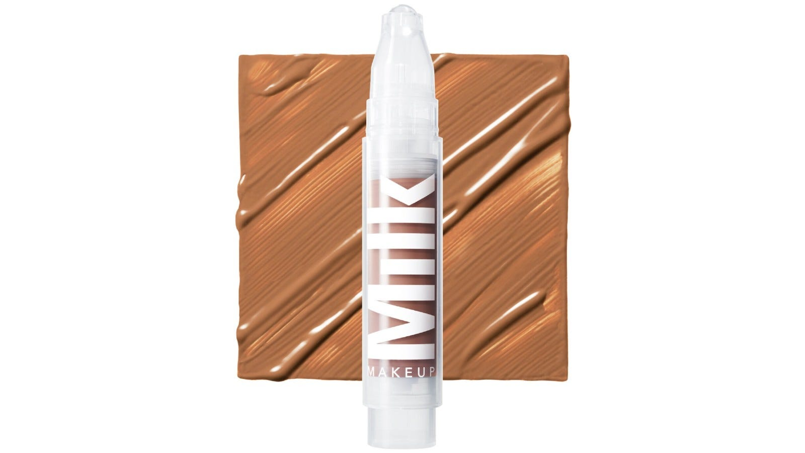 clear Milk Makeup foundation brush over a swatch of the makeup