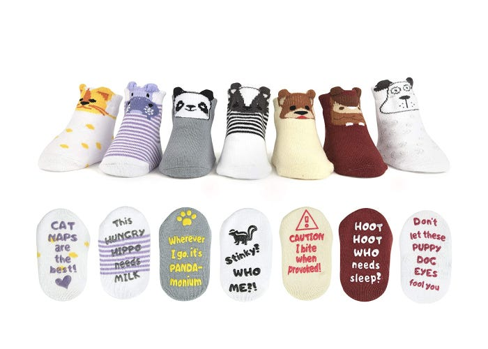 lined up baby socks with animal designs on the cuffs and quotes on the bottoms