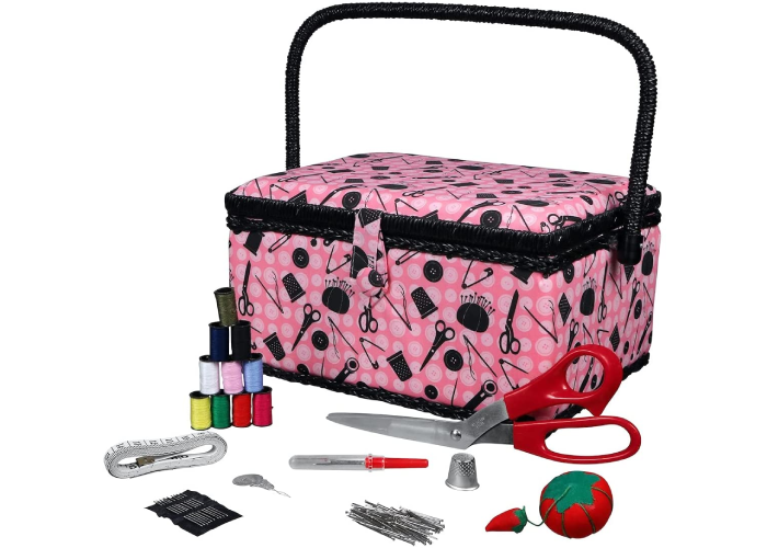a pink sewing box with handle and tools in front of it
