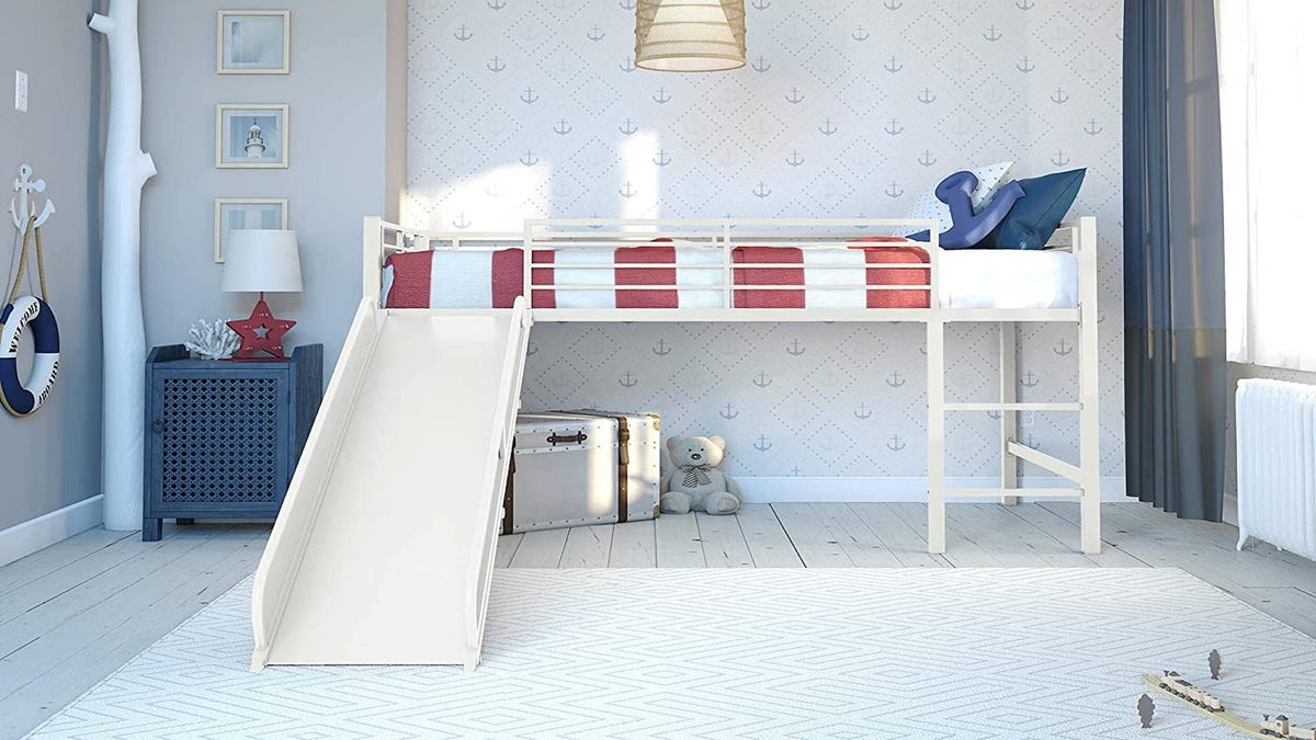 A white loft bed frame with a slide in a child's bedroom