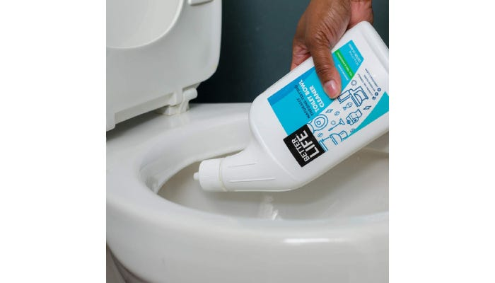 A person pouring a toilet cleaning product into their toilet.