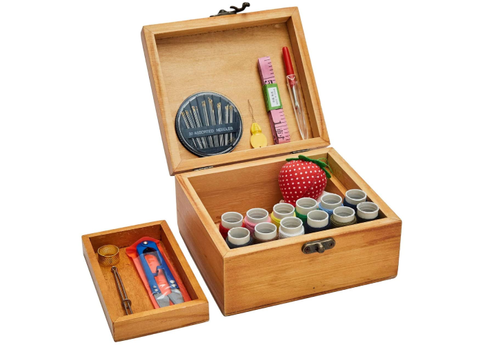 A wooden box sewing kit with tools inside and shelf pulled out and off to left side