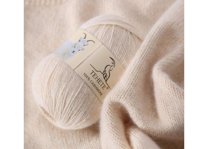 A ball of tan cashmere yarn