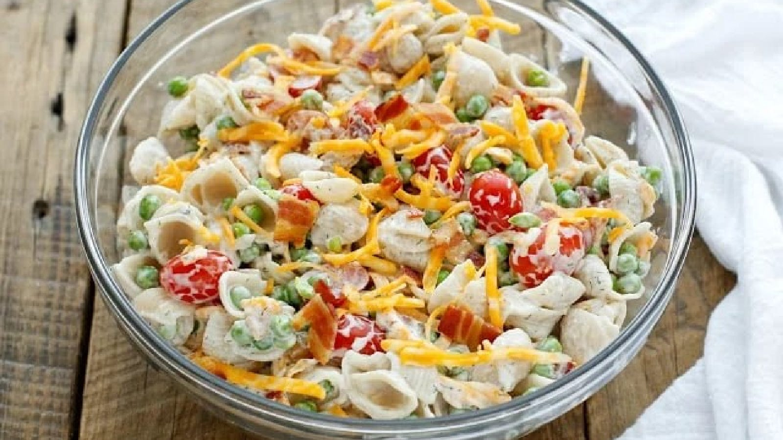 A large glass bowl filled with bacon ranch pasta salad.
