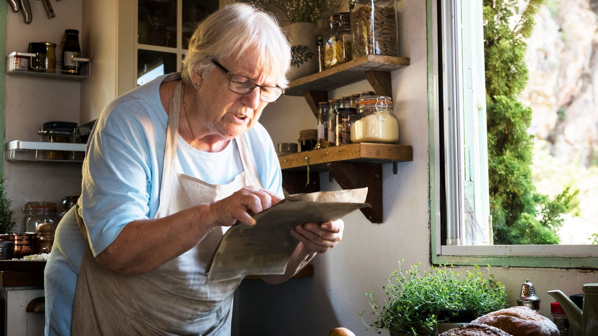 A woman trying to decipher a family recipe.