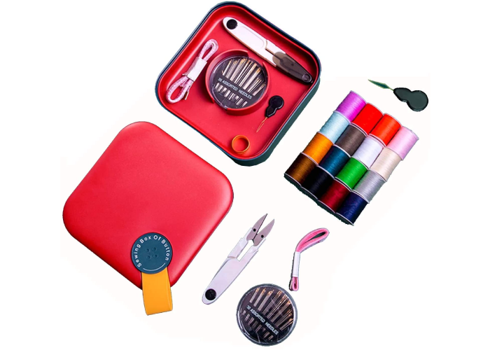 A red sewing kit with a button loop that is open and showing interior tools