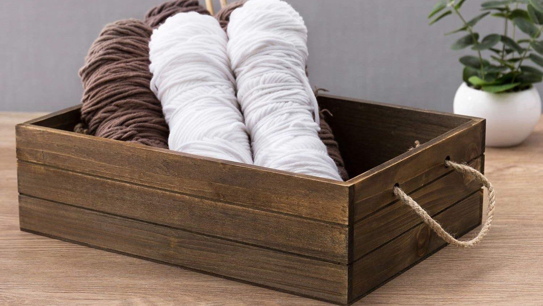 Rustic wood box with yarn in it.