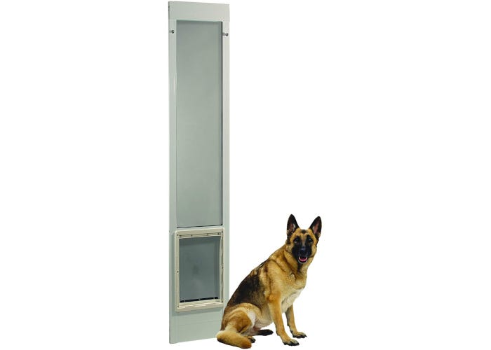 Dog door with transparent vinyl flap and animal lock-out slide for aluminum sliding patio doors