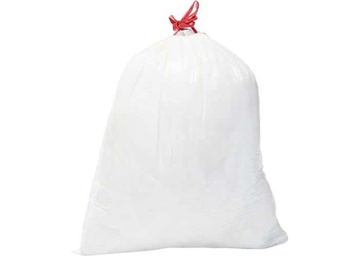 A full white trash bag with red drawstring handle on white background.