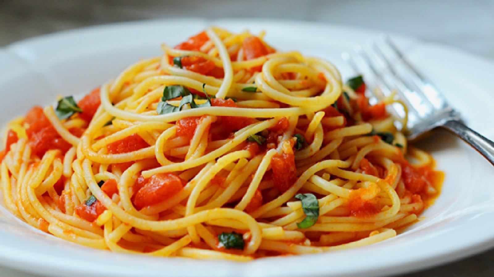 Spaghetti with homemade tomato basil sauce.