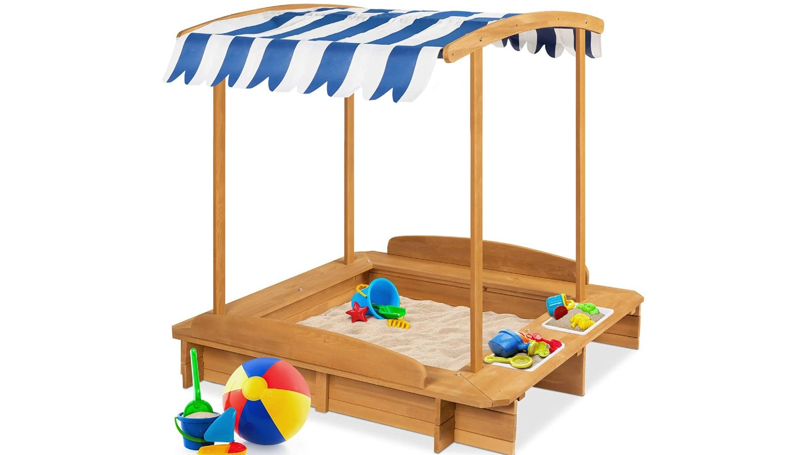 large wooden sandbox with a blue and white striped canopy