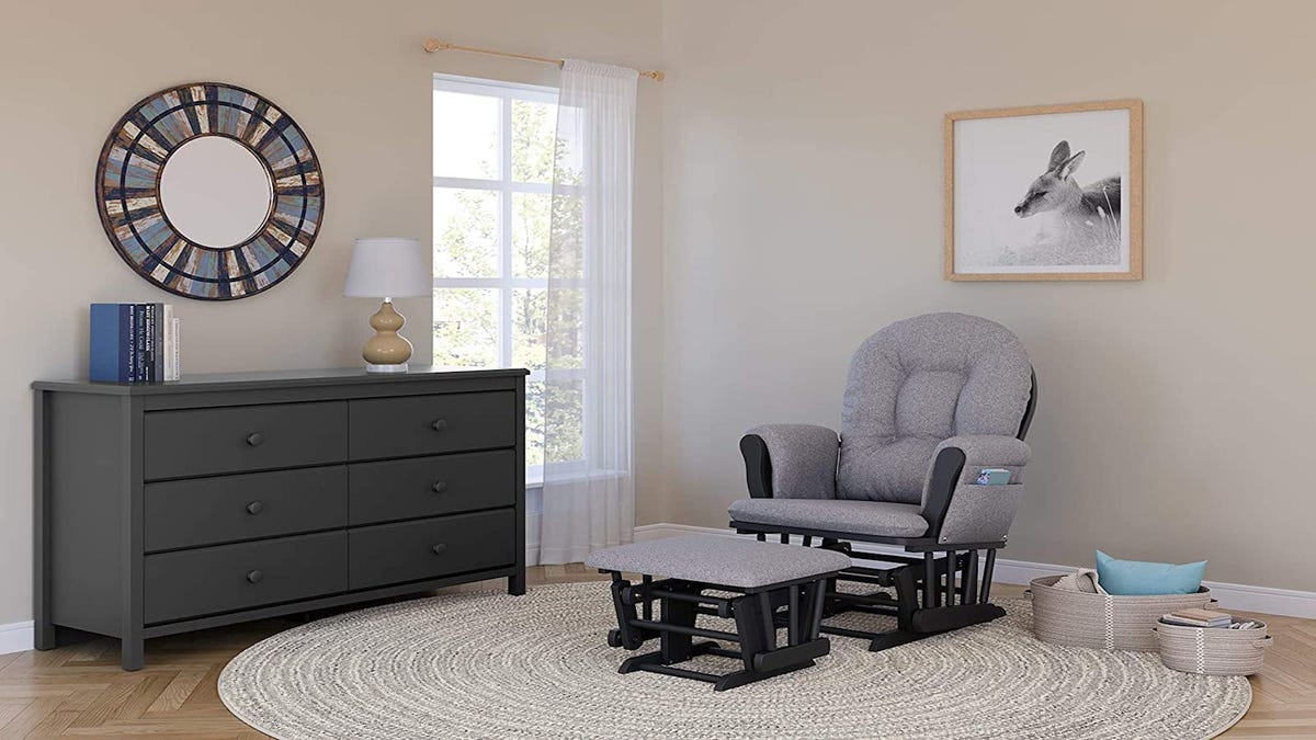 gray nursing chair and ottoman in a modern-designed bedroom