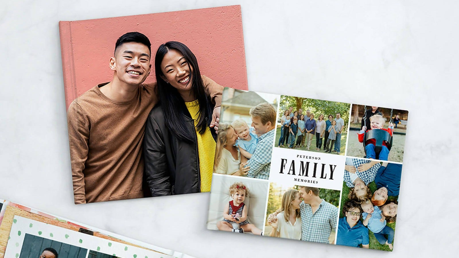 two photobooks featuring a photo of a smiling Asian couple and one of a variety of family photos
