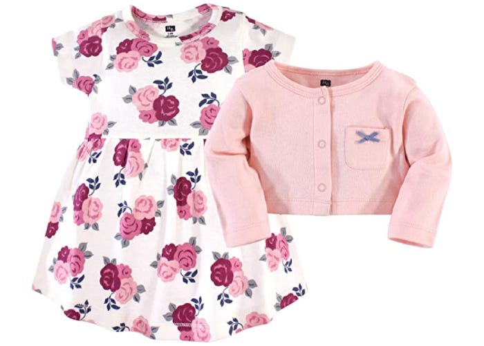 a baby dress with red and pink flowers and a pink cardigan