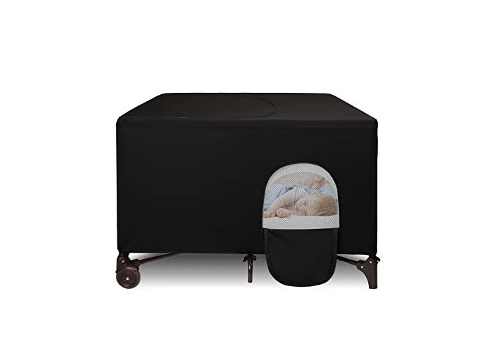 black out crib tent covering play yard with sleeping baby
