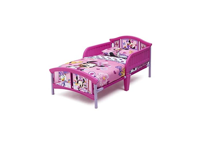 pink toddler bed with Minnie Mouse design