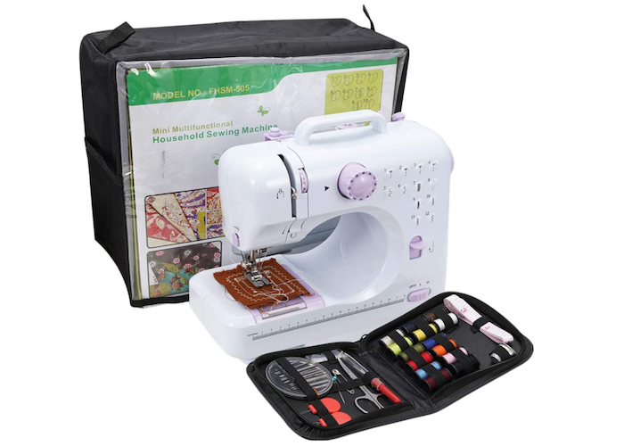 small white sewing machine with pale pink buttons beside a square black fabric carrying case and case of colored threads and other sewing accessories