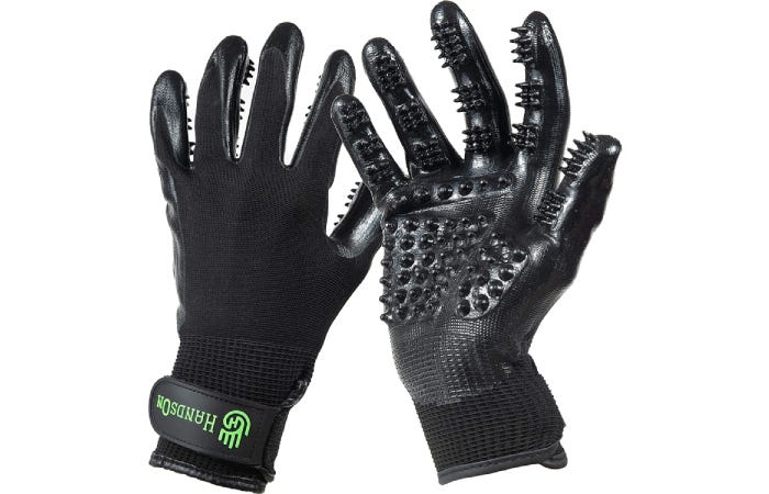 black gloves with protruding bumps to brush pet hair