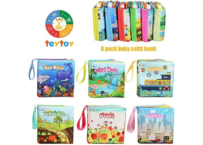 displayed cloth books with colorful pictures