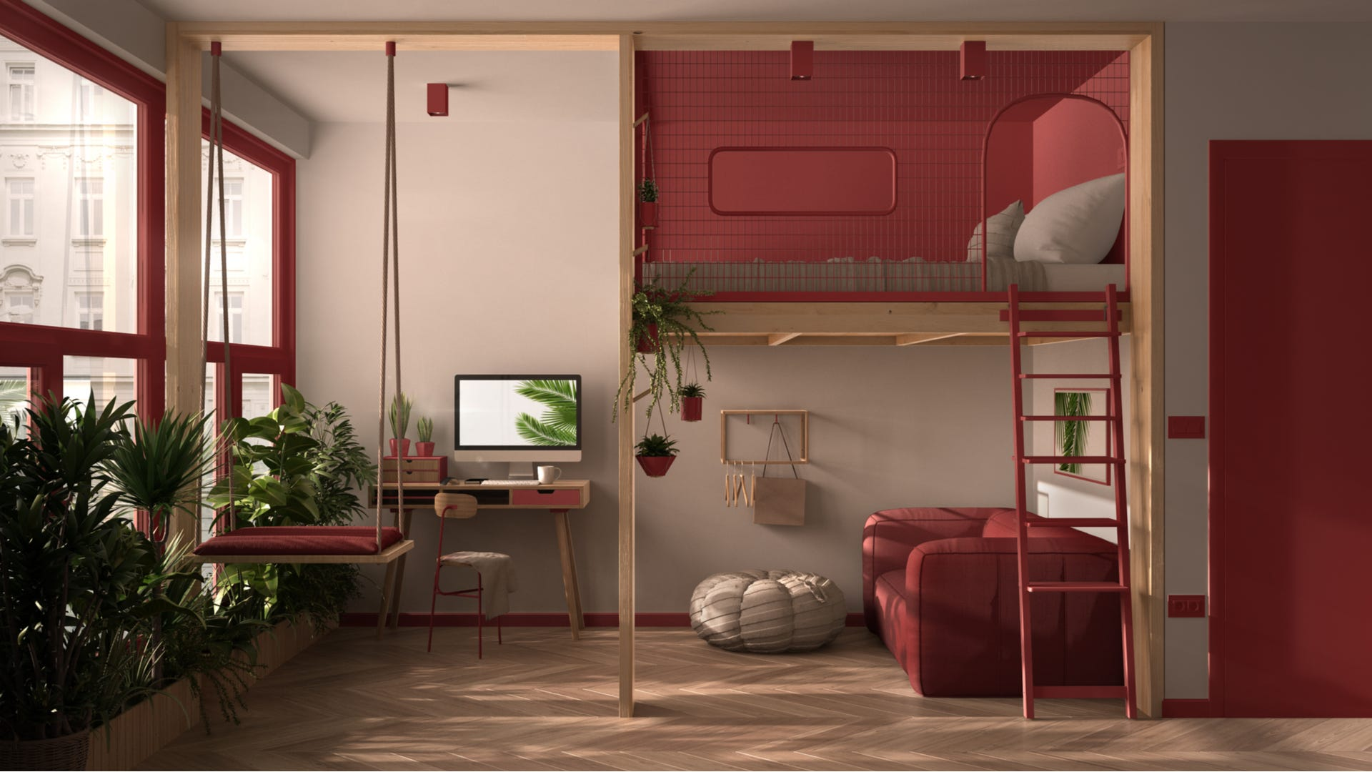 A modern and boho room with red accents. that has a loft bed above a couch and office space.