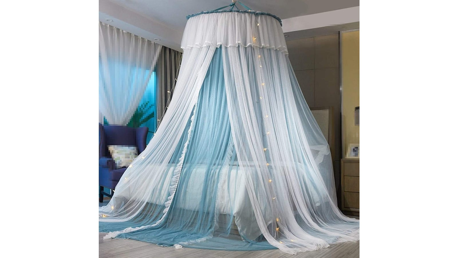 A large white and blue canopy hanging over a white bed.